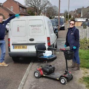 Lighthouse team delivering scooter