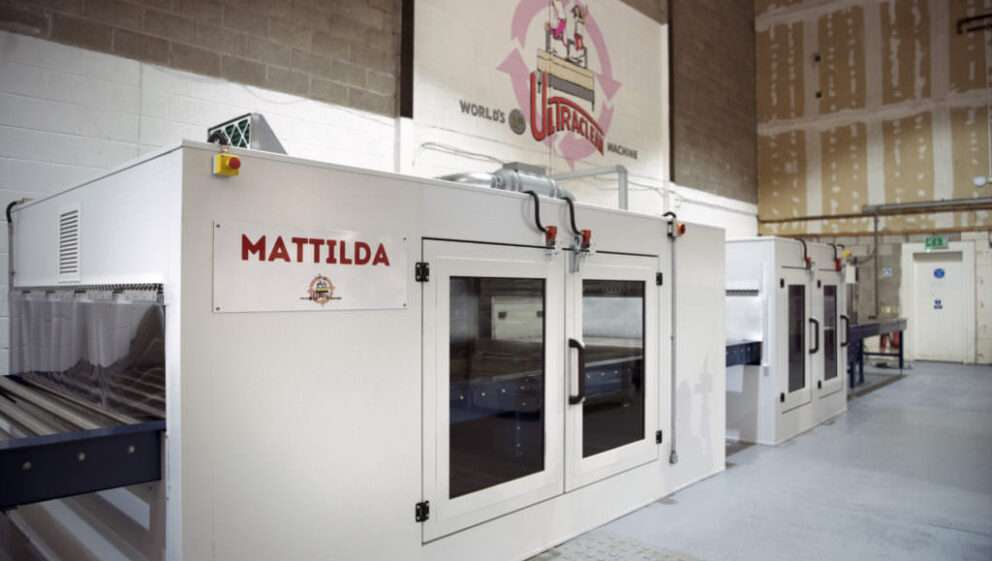 Image of the UltraClean Mattress Cleaning Machine in a large warehouse